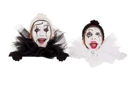 two funny clowns looking above a border Stock Photo - 18027101