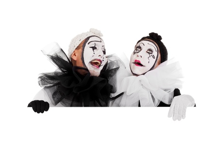 a couple of clowns are laughing above a border Stock Photo - 18027082