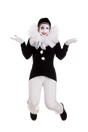 pierrot: funny female clown is jumping, isolated