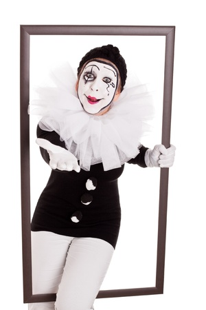 female clown in a frame is reaching hand to viewer photo