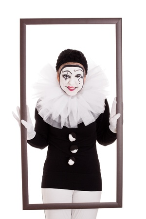 mimic: a female clown in a frame is looking angry