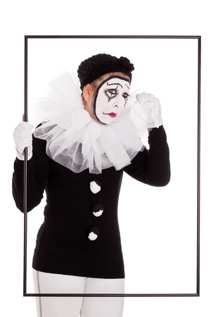 a female clown in a frame is crying photo