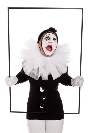 mimic: female clown in a frame is crying Stock Photo