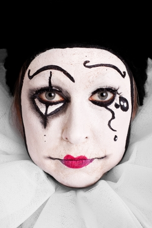 portrait of an sorrowful female clown photo