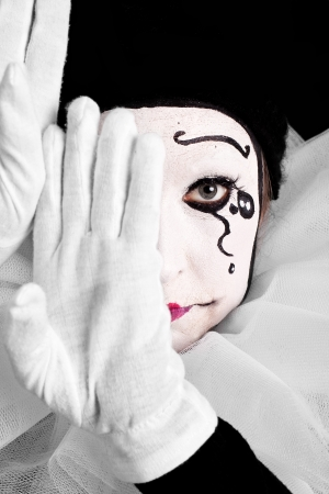 pierrot: portrait of an sad female clown