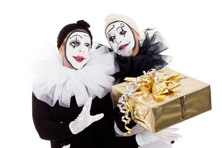 pierrot: two clowns with a golden present Stock Photo