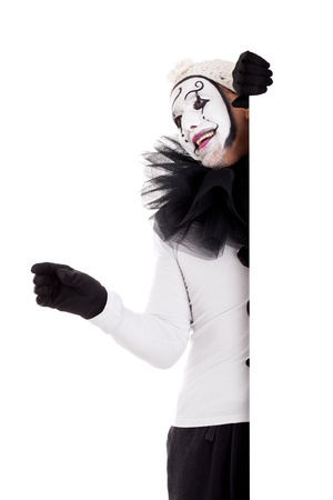 freaks: a male clown looks over a border and stretchs out his hand