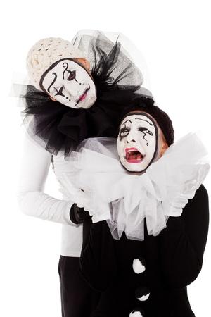 sorrowful: a couple sorrowful pierrots isolated Stock Photo