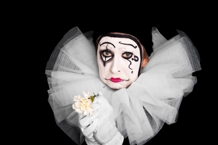pierrot: female clown with broken heart Stock Photo