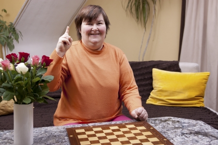 Mentally disabled woman has an idea and smiles photo