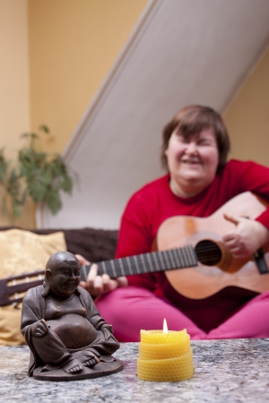 music therapy: mentally disabled woman experiences a music therapy Stock Photo