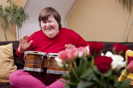 Mentally disabled woman plays drums Stock Photo - 18876129