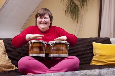 Mentally disabled woman enjoys her music therapy Banque d'images