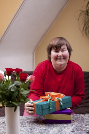 defective: Mentally defective woman holding many gifts