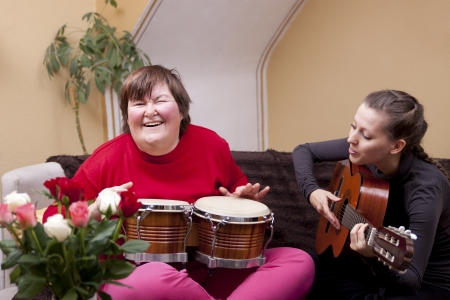 Two women make a music therapy and having fun photo