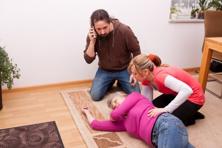 female senior is unconscious, childs calling  rescue service Stock Photo - 19226188