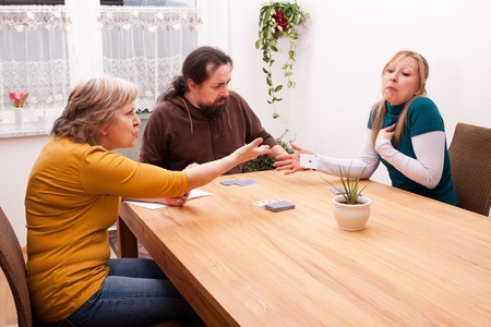 blond daughter cheating in card games with family photo