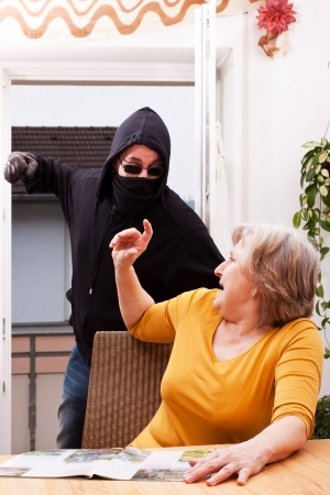 law breaker: Perpetrators of violence, coat of senior Stock Photo