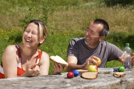 Couple has fun on picnics in nature photo