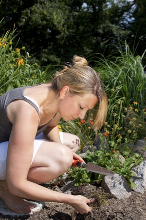 Young blond woman in the garden Stock Photo - 21622045