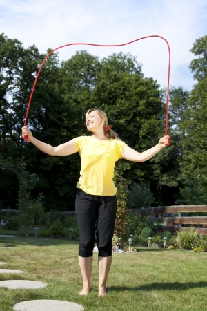 Young active woman has fun with jumping rope Stock Photo - 21622073