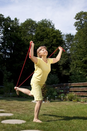 woman rope: Elderly woman doing exercises with the jump rope