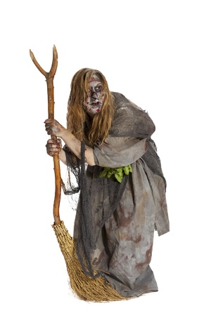 herbalist: Herbalist or ugly witch with broom Stock Photo