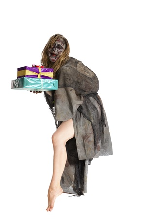 funny young witch with presents photo