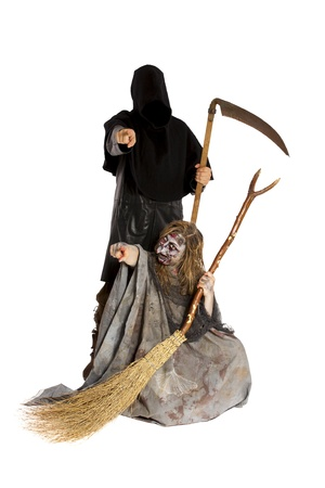 young witch and death point to viewer Stock Photo - 21622114