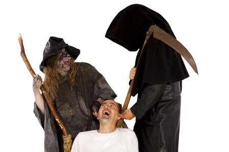 Death and young witch tug at victim Stock Photo - 21622116