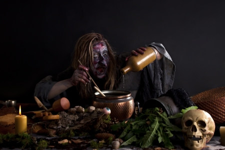 witchery: ygly witch brewing potion in laboratory