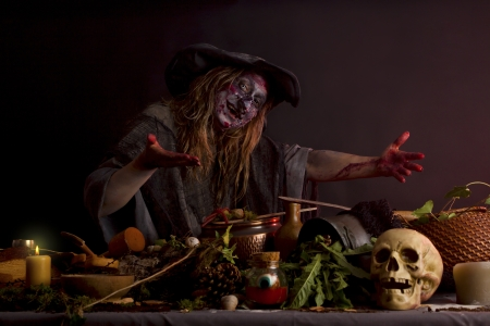 ugly witch shows her witch's kitchen photo