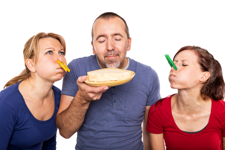smells: man smells on a stinky cheese Stock Photo