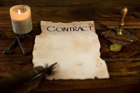 an old parchment with the word Contract photo