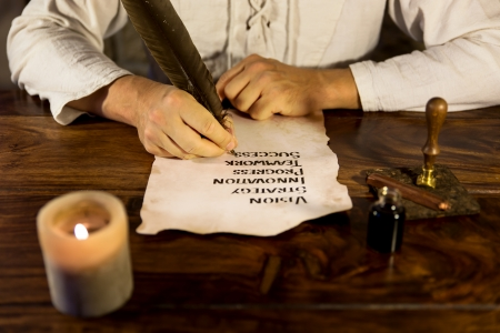 old writing: Man writes mystery to success on paper