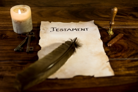 old document with the word Testament photo