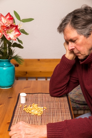alzheimer: portrait of a elderly man with medications Stock Photo