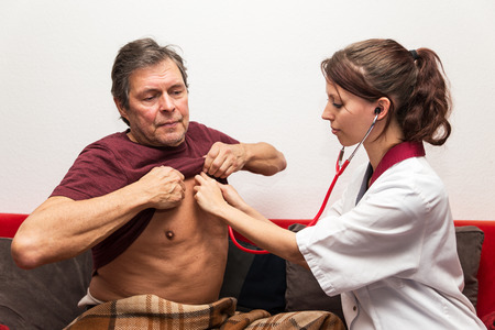 hypotension: doctor and patient checking heartbeat