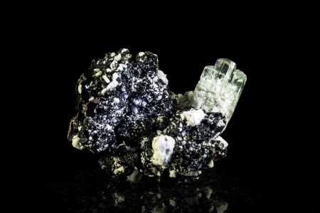 Aquamarine crystal with schorl in front of black Stock Photo - 25122185