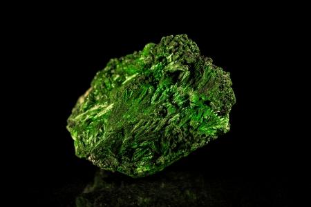 mineral stone: Malachite mineral stone in front of black