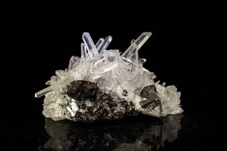 mineral stone: quartz mineral stone in front of black