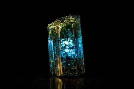 Indigolite mineral stone, black background Stock Photo - 25122224