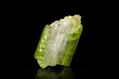 green tourmaline: green tourmaline with quartz in front of black Stock Photo