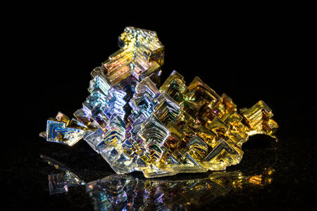 bismuth: Bismuth metal in front of black Stock Photo