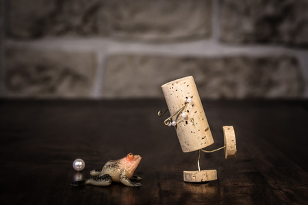 manlike: Concept frog prince fairytale with wine cork figure