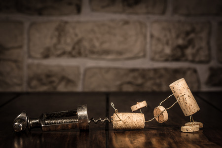 humanly: Concept escape from a corkscrew with wine cork figures