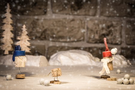 icescape: Concept funny snowball fight, wine cork figures