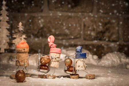 humanly: Concept harvesting icewine grapes, wine cork figures Stock Photo