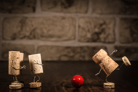 humanly: Concept going bowling with wine cork figures