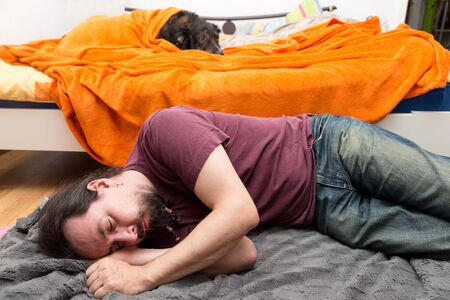 a Dog and Man change roles of sleeping Stock Photo - 25785628